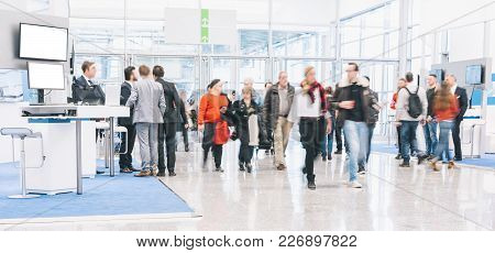 Anonymous Crowd People Rushing At A Trade Show. Ideal For Websites And Magazines Layouts
