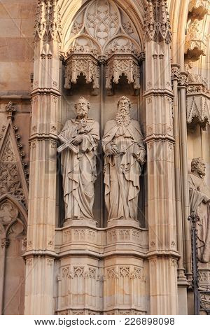 Statues Of Two Saints On A Spanish Church