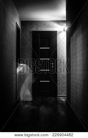 Ghost Walks Through The Old House At Night. Home Bogle In A White. Ghost In The Dark Room