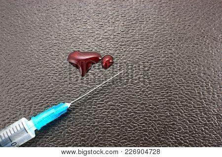 Drops Of Blood Syringe Against A Dark Background, Concept Of Criminal Medicine