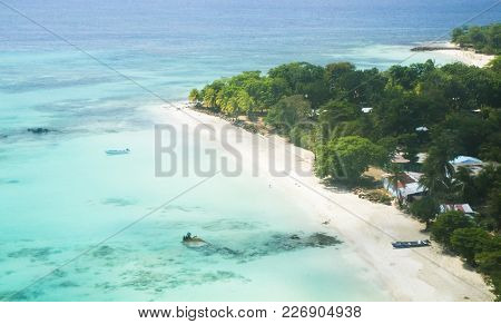 An Idyllic Tropical Island Beach With White Sand And Palm Trees. Big Corn Island, Nicaragua.