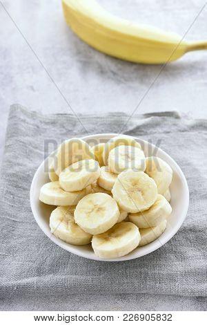 Banana Slices In Bowl. Healthy Natural Vitamin Food Or Vegetarian Vegan Food Concept.