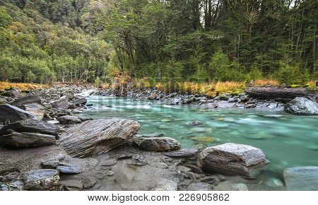 The Matukituki River Is Colored A Deep Green Color From The Rock Flour Generated By Glaciers That Fe