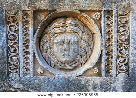 The Roman Theatre Mask Is Carved In Stone. The Mask In Ancient Greek Theatre The Relief On The Stone