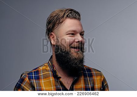 Studio Portrait Of Laughing Bearded Male In Yellow Shirt Isolated On Grey Background.