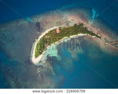 Atoll Island Above View In Blue Caribbean Sea Water