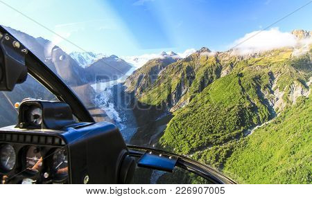 View From The Cockpit Of A Helicopter As It Flies Over The Fox Glacier On New Zealand's South Island