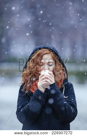 Mindfulness Woman Drinking A Hot Beverage Under The Snow