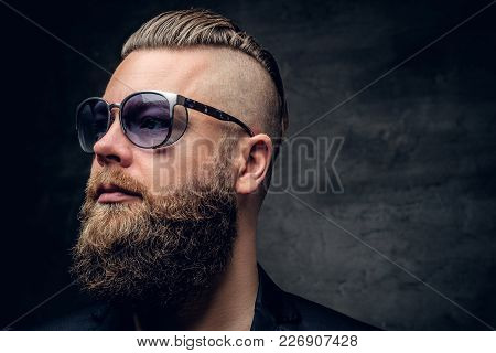 Fashionable Portrait Of Bearded Male In Purple Sunglasses Isolated On Grey Vignette Background.