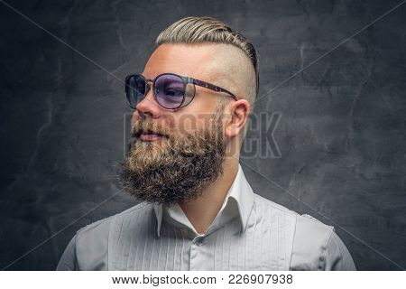 Studio Portrait Of Bearded Male With Punk Hairstyle Dresses In A White Shirt And Violet Sunglasses O
