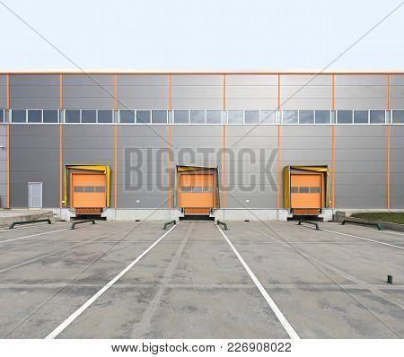Three Cargo Doors At Warehouse Loading Bay
