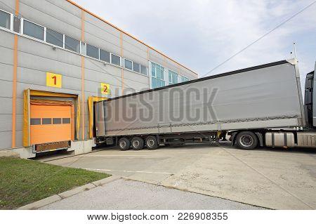 Loading Lorry Trailer At Warehouse Dock Door