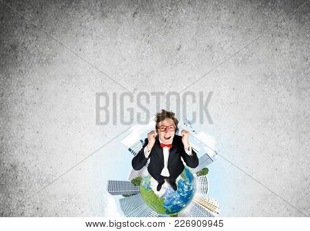 Top View Of Funny Businessman In Red Glasses Celebrating Success. Elements Of This Image Are Furnish