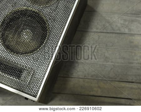 Old Gray Speaker On A Gray Background