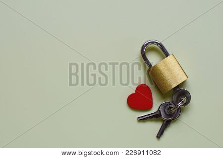 Key To Heart For True Love. Lonely Heart. Composition With Lock, Key And Heart On Very Light Green B