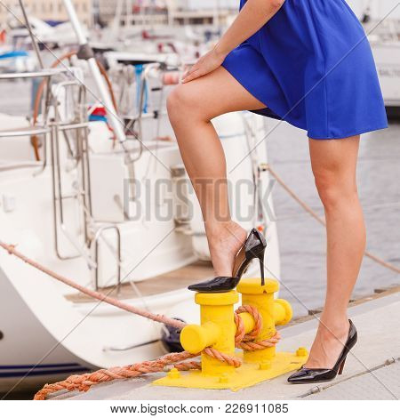 Power Of Woman, Fashion, Clothing, Feminism Concept. Woman In Short Blue Dress And High Heels Standi