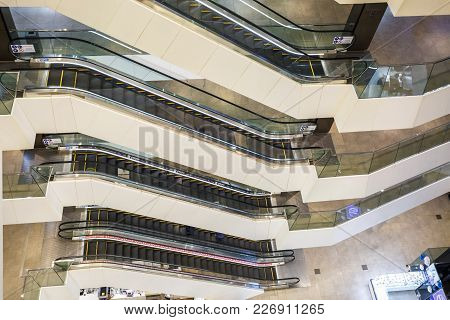 Minsk, Belarus - February 13, 2018: Interior Stylish Modern Trade Centre. View Of Escalator And Movi
