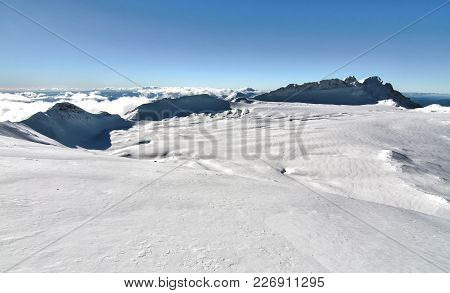 Large Snowfield In The Crater Of Mt. Ruapehu In New Zealand.