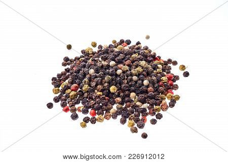 Black, Red And White Peppercorns Isolated On White Background. Heap Of Spice. Mix Of Different Peppe
