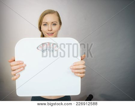 Teenage Woman Holding Bathroom Scale Machine Thinking About Weight Loss And Proper Body Mass. Being