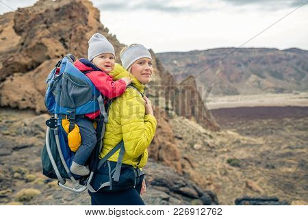 Family Hike, Mother With Baby In Backpack