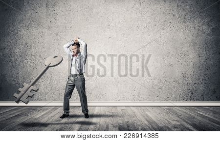Determined Businessman In Concrete Interior Breaking With Hands Stone Key Figure
