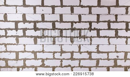 Brick Wall As Background. Texture . Photo Of An Abstract Texture