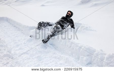 Man Is Falling Into Deep Snow. Winterly Slippery Conditions And Dangerous Accident Concept.