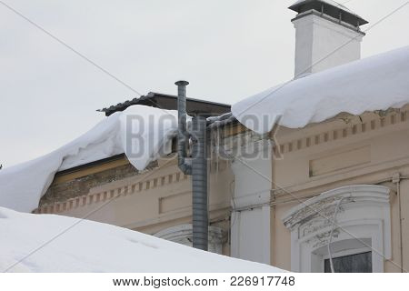 Snow Falls Hanging Down From The Roof, Urban Landscape