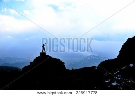 Lonely And Successful Climber In Magnificent Mountains