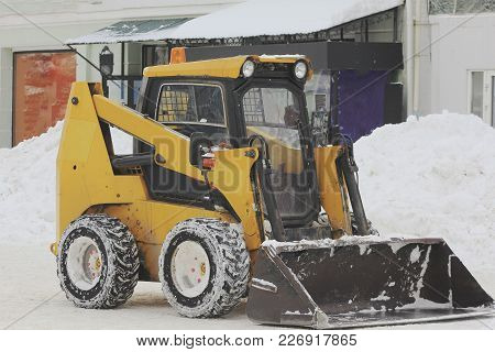 Clearing Snow From The Road With Bulldozer In The City In Winter, Urban Landscape