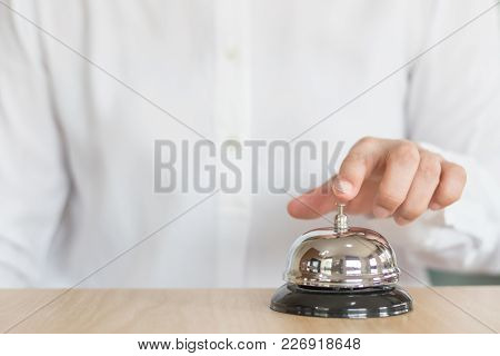 Hotel Restaurant Bell Service On Concierge Customer Reception Counter With Business Person Ringing P