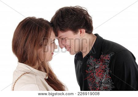 A Happy Young Couple Standing With There Forehead Together In A  Closeup Image, Isolated For White B