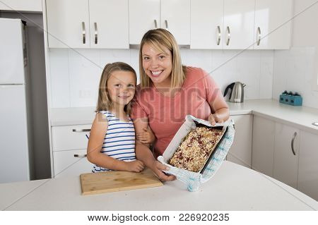 Young Mother And Her Sweet Beautiful 7 Years Old Daughter Showing Proud Strawberry Cake After Baking