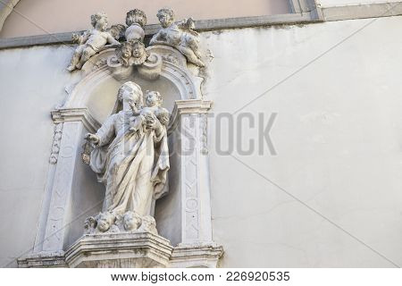 Udine, Italy /udine, 14/02/2018: Photo Of A Statue Of The Facade Of The Church Dedicated To The Bles