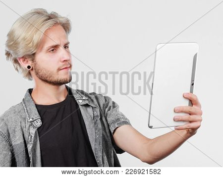 Education Social Media. Modern Technology Internet Concept. Stylish Handsome Young Man Using Tablet