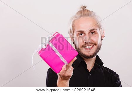 People Celebrating Xmas, Love And Happiness Concept - Cool Young Man Holding Present Pink Gift Box I