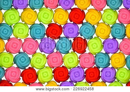 Jelly Mould Pattern, Top View Photo Of Colorful Jelly Mould Arranged On White Bright Background Pres