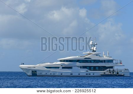 Mega Yacht In Caribbean Islands With Clouds