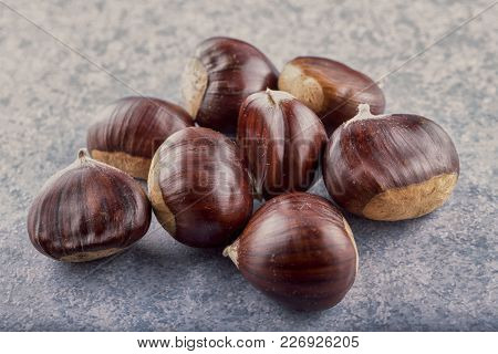 Chestnuts Over Blue Stone Background