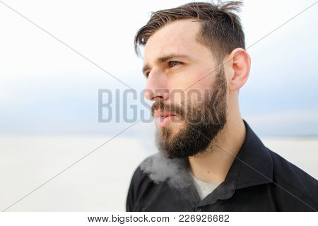 Geographer Male Smoking, Young Man Come To Seaside To Carry Out Research. Bearded Guy With Short Fai