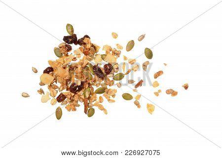 Isolated Granola/muesli, A Top View Closeup Photo Image On Scattered Granola/muesli Grain Isolated O