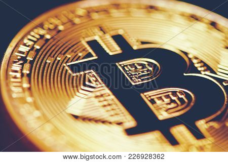 Golden Bitcoin. Closed Up Bit Coin. Cryptography And Electronic Money Concept. Currency Trading And