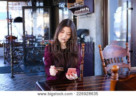 Teacher Check Tests In Cafe Using Smartphone, Young Asian Woman Sitting Near Table With Phone In Pin
