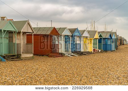 Beach Huts On A Pebble Beach Between Hampton And Herne Bay, Kent, England, Uk