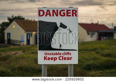 Sign: Danger Unstable Cliffs Keep Clear, Seen In  Reculver, Kent, England, Uk