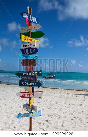 Playa Del Carmen, Mexico - February 5, 2018: Funny Direction Signpost With Distance To Many Differen