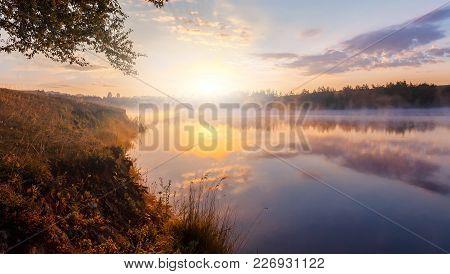 Beautiful Background Of Nature. Wonderful Misty Landscape. Amazing Foggy Morning, Colorful Sky Refle