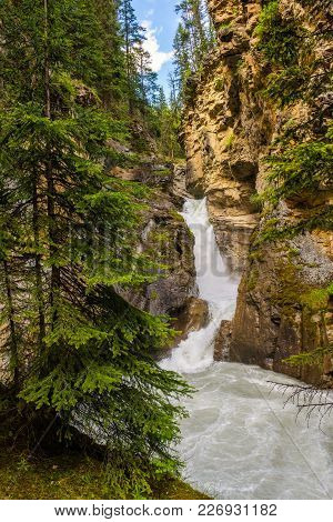 Lower Falls In Johnston Canyon, Canada. Johnston Canyon Is One Of The Most Popular Day Hikes In Banf