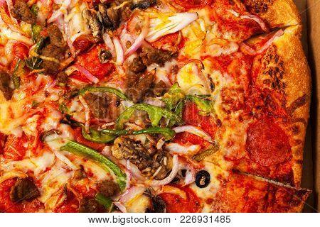 Homemade Italian Fresh Pizza Background. Selective Focus.